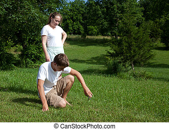 Yard Work - A teenage boy and woman doing yard work.