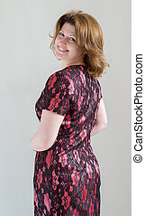 Woman in a dress on  light background