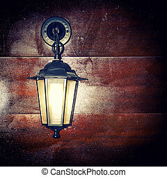 lantern - Lamp lantern on a wooden background