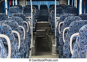 Blue empty seats in the bus