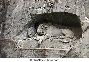 Statue of dying lion in Lucerne - Statue of a dying lion in...