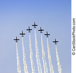 Planes on an air show against clear sky