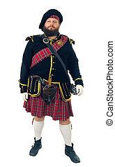 Scottish warrior in the medieval uniform