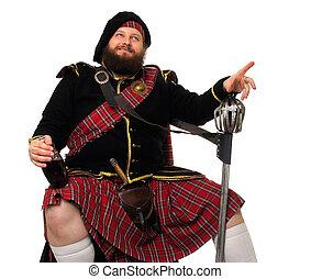 Scottish warrior with bottle of red wine - Scottish warrior...