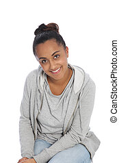 Smiling Girl in Casual Clothing Sitting on Floor