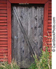 Old farm barn door - Old weathered wooden country farm barn...