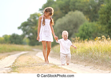 Small Brother and sister in summer nature - portrait of...