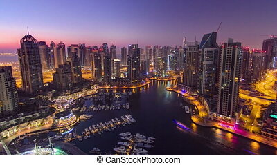 Dubai marina harbor panorama from night to day transition timelapse
