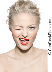 Beauty Wink - Model wearing red lipstick and winking.