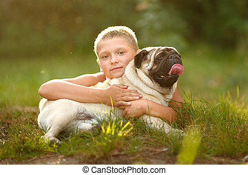 Portrait of a boy with dog pug