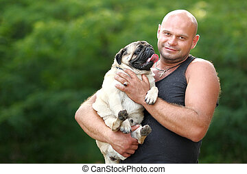 portrait of a man and his dog pug
