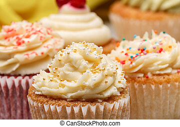 cupcakes with white cream on the table