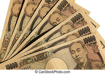 A pile of 10000 Japanese Yen notes isolated on white