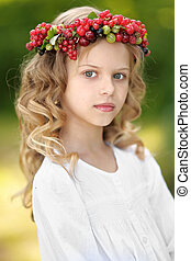 portrait of a beautiful little girl with berries
