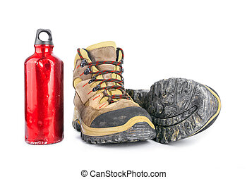 Hiking equipment - Used Dirty hiking boots and old battered...