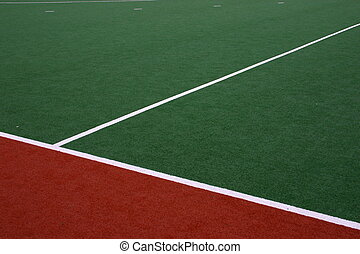 The sideline of a synthetic hockey field