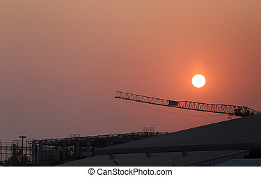 Sunset and plant currently under construction - Sunset and...