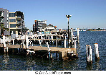 old jetty next to redeveloped harbor area - Newcastle...
