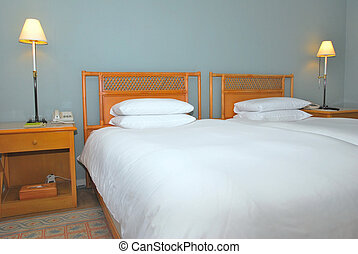 Twin beds in modern hotel room - Twin beds with table lamps...