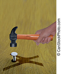 Employee harassment Concept, Hammer in Human Hand hitting a nail