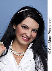 Fashionable woman in white with pearls