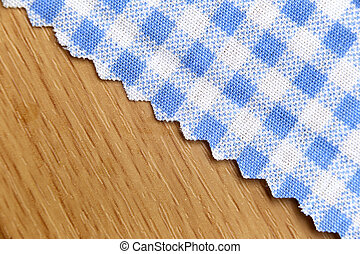 blue fabric of scots pattern on wood