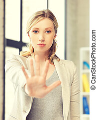 young woman making stop gesture - picture of young woman...