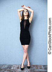 Full length portrait of a beautiful woman in vogue dress