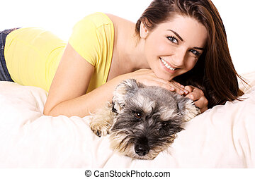 Girl with her adorable Schnauzer - A pretty young smiling...