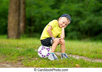 Portrait of cute little boy in summer