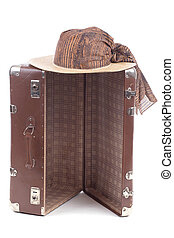 vintage suitcase with straw hat over white background