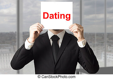 businessman in office hiding face dating - businessman in...