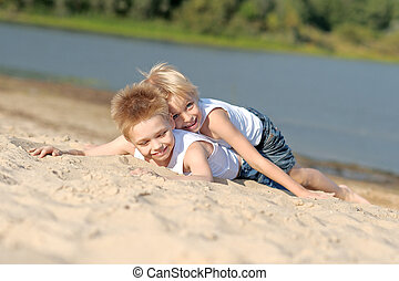 portrait of two little boys on the beach in summer