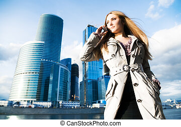 Young businesswoman with mobile phone On modern city...