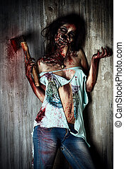 murderer - Scary bloody zombie girl with an ax. Halloween.