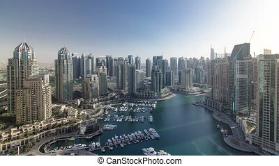Modern buildings in Dubai Marina with shadows moving very fast timelapse, Dubai, UAE.