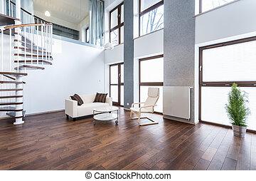 White sofa in empty interior - Horizontal view of white sofa...