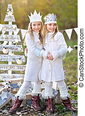 portrait of two  little  girls in a Christmas style