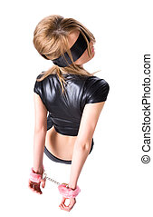 Young woman with pink handcuffs. Backside view.