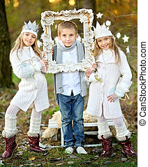 portrait of little boys and two girls i in a Christmas style...