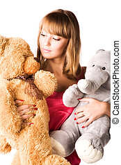 Young woman with toys