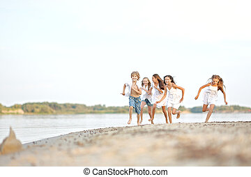 Portrait of children on the beach in summer