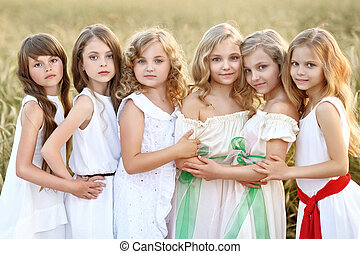 portrait of six little girls in cornfield field
