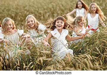 portrait of little girls running on the field