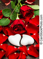 Red roses and two white hearts. Valentines Day or Wedding card