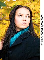 Young brunette woman autumn portrait