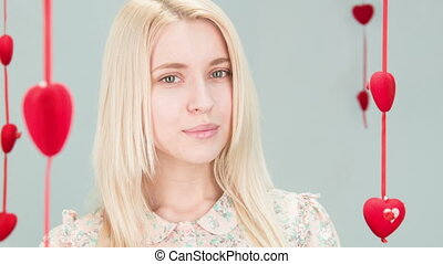 elegant lady with blond hair - close up portrait of a cute...