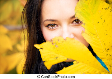 Woman with yellow leaves portrait