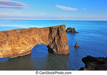 The colossal rock in the sea - Cape Dyrholaey in southern...