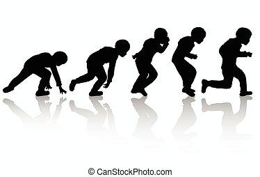 little boy running outdoors
